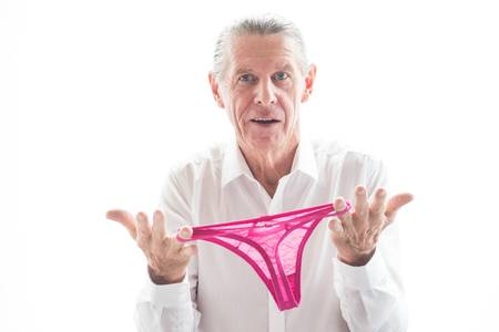 71084774-closeup-of-confused-senior-man-holding-panties--1-
